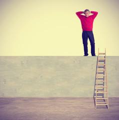 Tired man climbing a ladder