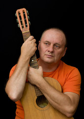 Portrait of mature man - amateur guitarist