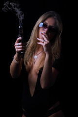 Beautiful sexy girl with a gun and cigarette with glasses