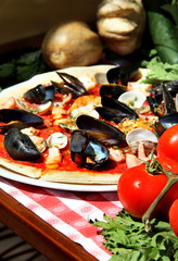 Mediterranean pizza with sea products and mussels