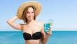 Woman in bikini having a drink
