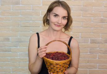 - woman holds a basket of berries