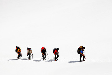 Team of alpinists crossing a glacier