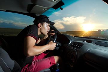 man sitting in the car