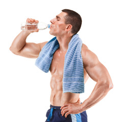 Young muscular man, drinking water, isolated on white