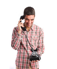 young man laughing on phone