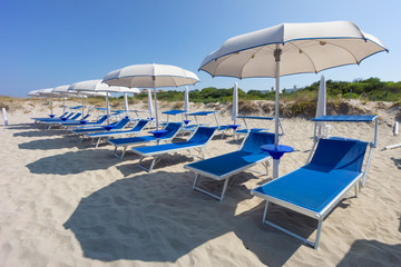 sunbeds and beach ubrellas in Gallipoli, Apulia, Italy
