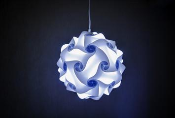 Modern designer lamp in blue light
