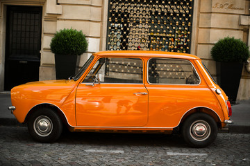 Retro car orange color purity in the street
