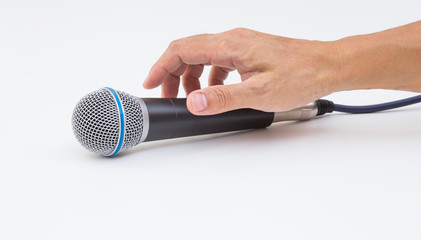 Hand grabbing microphone on white background