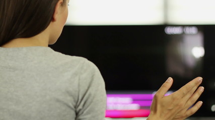 Woman interacting with futuristic touch screen
