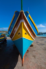Traditional Maltese colorful boat in Marsaxlokk village