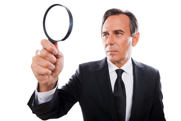 Businessman with magnifying glass.