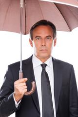 Businessman with umbrella.