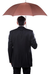 Businessman with umbrella.