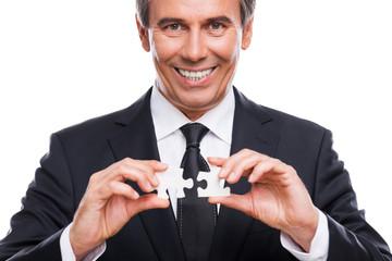 Businessman with puzzle elements.