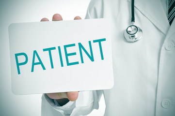 doctor showing a signboard with the word patient written in it