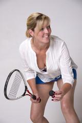 Squash player serving