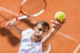 Young man playing tennis - 68183333
