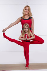 Mother daughter doing yoga exercise fitness gym sports pairedred