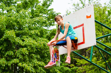 Young girl sitting in hoop