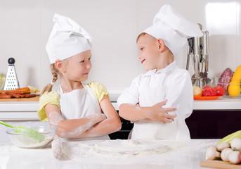 Supercilious little boy chef
