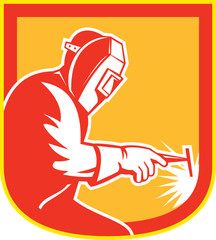 Welder Holding Welding Torch Shield Retro