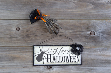 Halloween hand and sign on wood