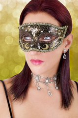 Beautiful young woman in carnival mask.