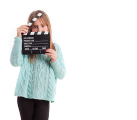 Young girl with a clapboard