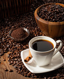 Fototapety Cup of Black Coffee with Beans