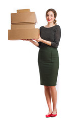 Young girl holding a boxes