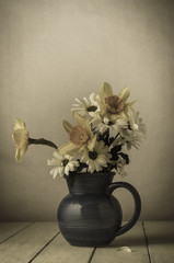 Old Fading Flowers in Blue Jug