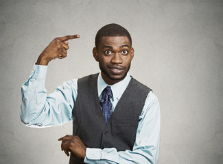 Man asking are you crazy, idiot? isolated grey wall background