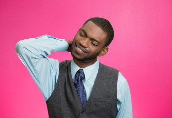 Portrait young man with neck, back pain, pink background