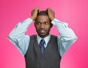 Stressed man pulling out hair, frustrated face expression