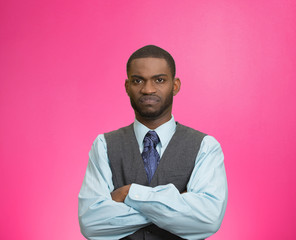 Grumpy, skeptical, displeased man isolated pink background