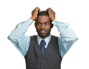 Portrait Stressed man pulling his hair out, white background