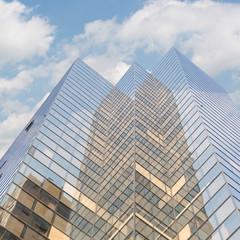Office skyscraper under dramatic sky