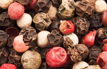 Raw Whole Four Peppercorn Blend against a background