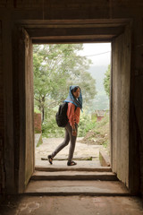 Woman through doors