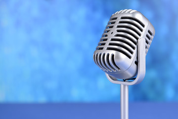 Vintage microphone on blue background