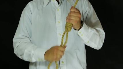 Man checks the noose.