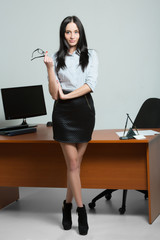 beautiful business woman holding glasses