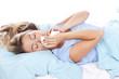 canvas print picture - Junge Frau mit Taschentuch im Bett