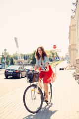 Beautiful woman in dress with bike