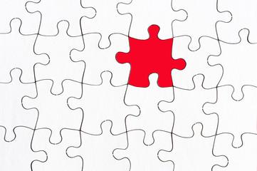 blank jigsaw with one red piece