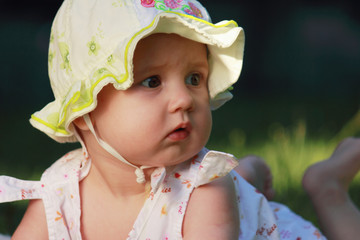 surprised adorable baby on green grass