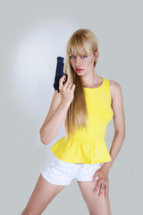 Pretty girl in action with hand gun