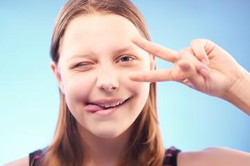 Winking teen girl